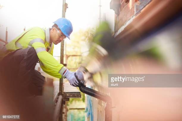 gutter installation - black glove stock pictures, royalty-free photos & images