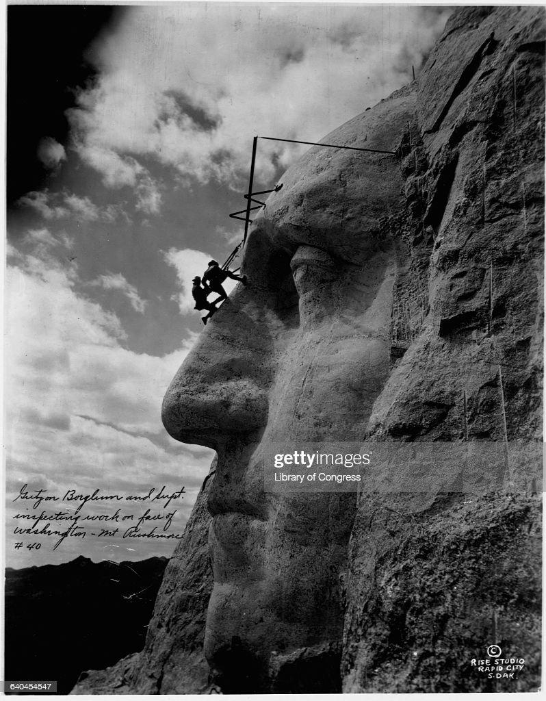 Gutzon Borglum Inspecting Washington's Statue on Mount Rushmore : News Photo