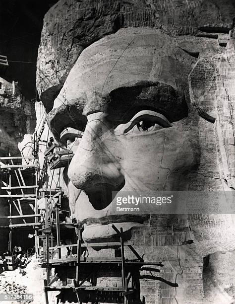 Gutzon Borglum works on the eye of Abraham Lincoln during the construction of the Mount Rushmore Memorial