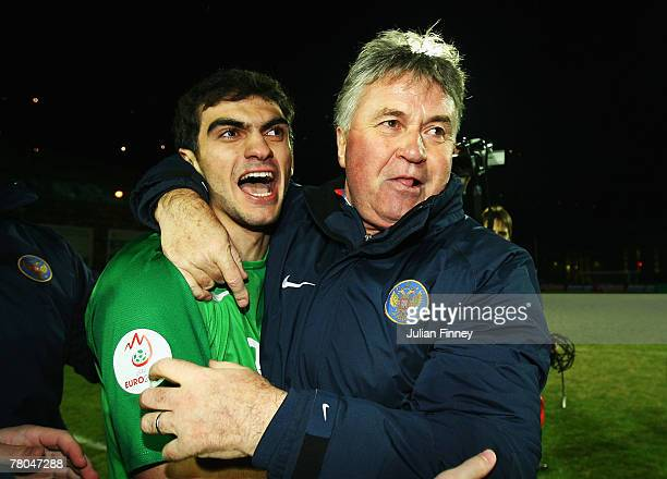 Guus Hiddink coach of Russia celebrates with goalkeeper Vladimir Gabulov of Russia after their team qualifies for the Euro2008 Championships after...