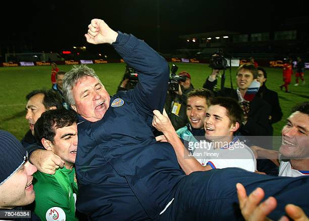 Guus Hiddink coach of Russia celebrates with his players after winning their match against Andorra during the the Euro2008 Qualifier match between...