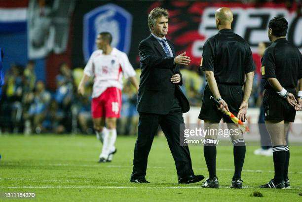 Guus Hiddink coach of South Korea shakes hands with argues with the referee Byron Moreno after the World Cup round 16 match between South Korea and...
