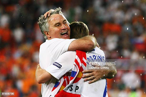 Guus Hiddink head coach of Russia celebrates victory with Dmitri Torbinskiy of Russia after the UEFA EURO 2008 Quarter Final match between...