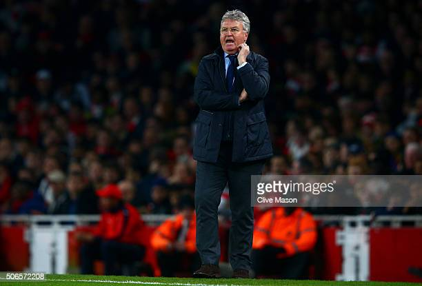 Guus Hiddink manager of Chelsea issues instructions to his players during the Barclays Premier League match between Arsenal and Chelsea at Emirates...