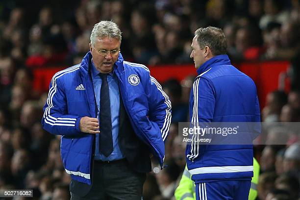 Guus Hiddink manager of Chelsea speaks with his assistant coach Steve Holland during the Barclays Premier League match between Manchester United and...