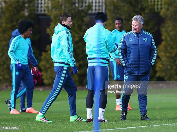 Guus Hiddink manager of Chelsea talks to players during a Chelsea training session ahead of their UEFA Champions League round of 16 match against...