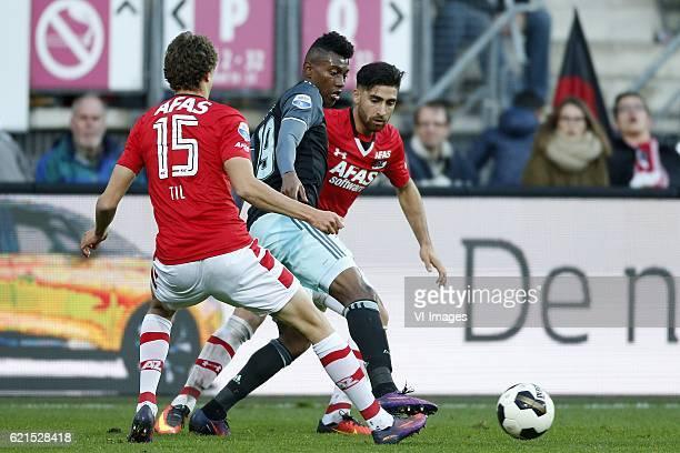 Guus Til of AZ Alkmaar Bertrand Traore of Ajax Alireza Jahanbakhsh of AZ Alkmaarduring the Dutch Eredivisie match between AZ Alkmaar and Ajax...
