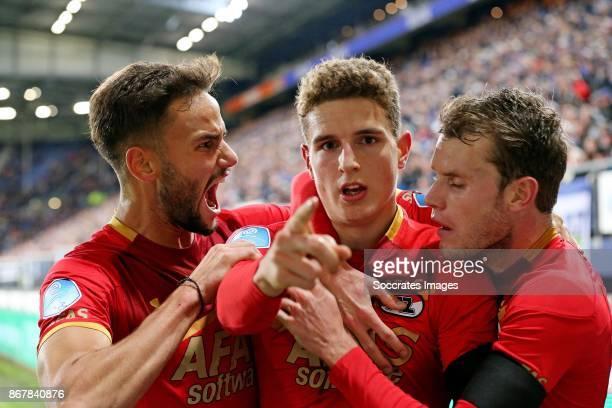 *Guus Til* of AZ Alkmaar celebrates 11 with *Pantelis Hatzidiakos* of AZ Alkmaar abd *Thomas Ouwejan* of AZ Alkmaar during the Dutch Eredivisie match...