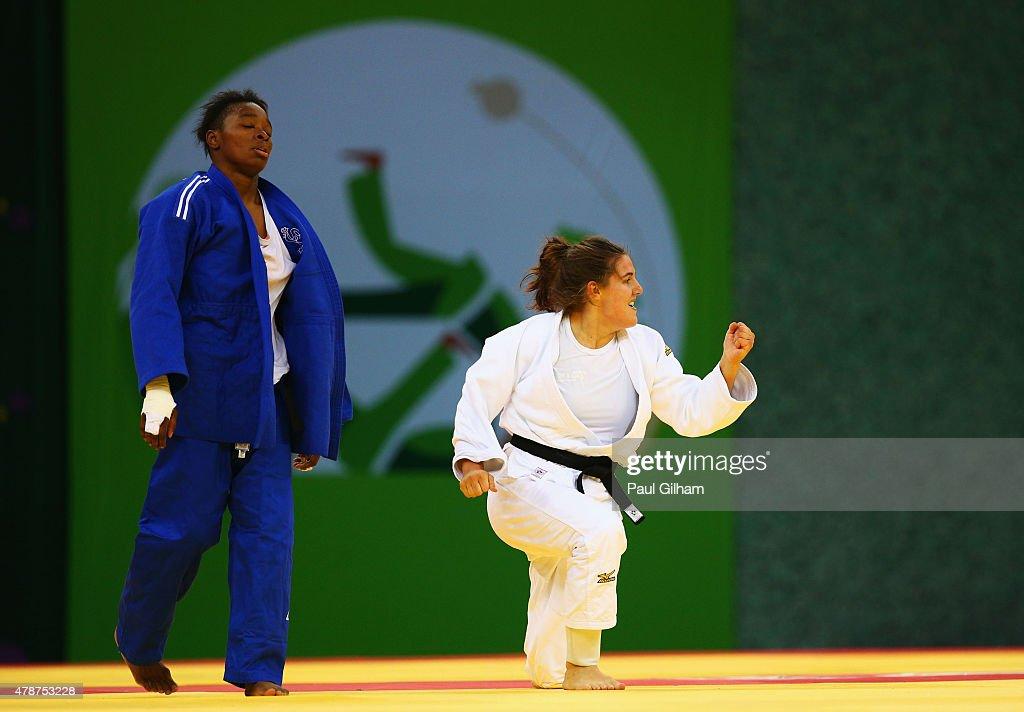 Guusje Steenhuis of the Netherlands (white) celebrates victory over Audrey Tcheumeo of France (blue) in the Women's Judo -78kg Bronze Final during day fifteen of the Baku 2015 European Games at Heydar Aliyev Arena on June 27, 2015 in Baku, Azerbaijan.
