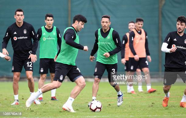 Guven Yalcin and Adriano Correia of Besiktas attend a training session ahead of Turkish Super Lig match against Medipol Basaksehir in Istanbul Turkey...
