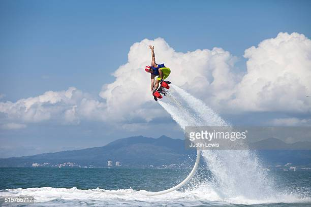 Guy Airboarding Pacific Ocean, Mountains in Backgr