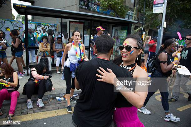 A guy and a girl break off to waltz together on Monday on 28th August 2016 at the 50th Notting Hill Carnival in West London A celebration of West...