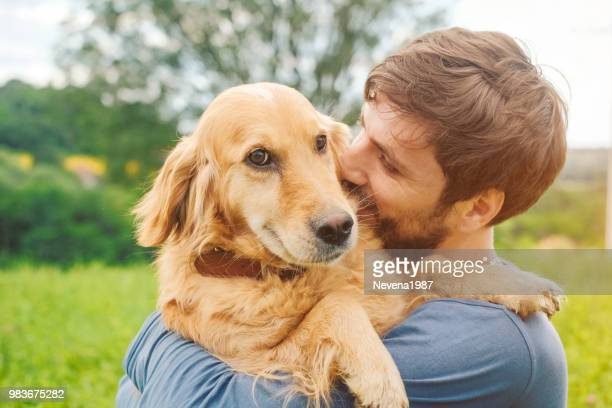guy and his dog, golden retriever, nature - dog stock pictures, royalty-free photos & images