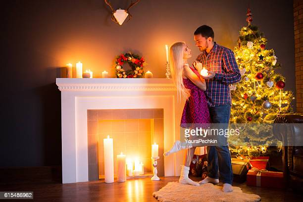Guy and his girl near the Christmas tree