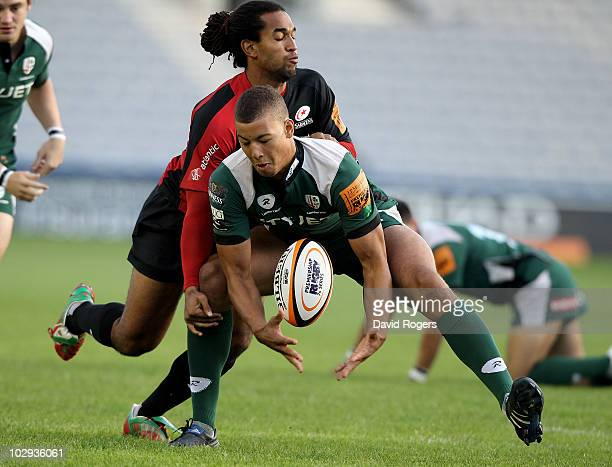 Guy Armitage of London Irish is tackled by Noah Cato of Saracens during the JP Morgan Asset Management Premiership 7's at the Stoop on July 16 2010...