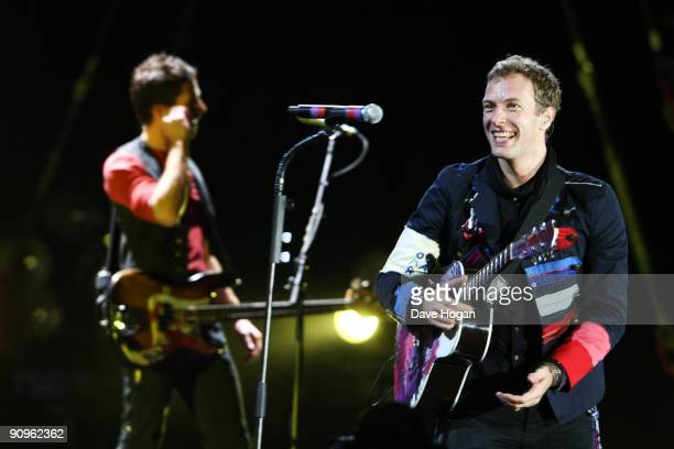 Guy Berryman and Chris Martin of Coldplay perform at Wembley Stadium as part of the 'Viva la Vida' tour on September 18 2009 in London England