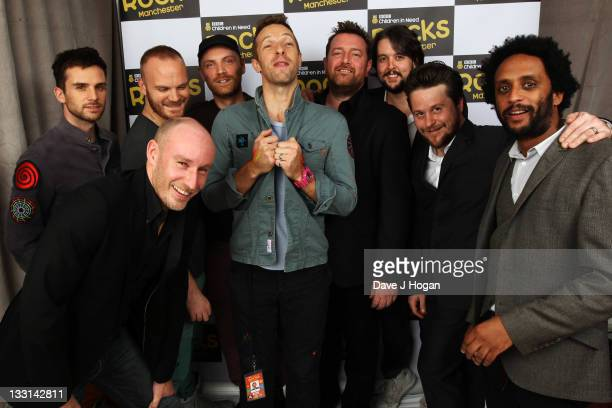 Guy Berryman Richard Jupp Will Champion Jonny Buckland Chris Martin Guy Garvey Craig Potter and Pete Turner of Coldplay and Elbow pose backstage at...