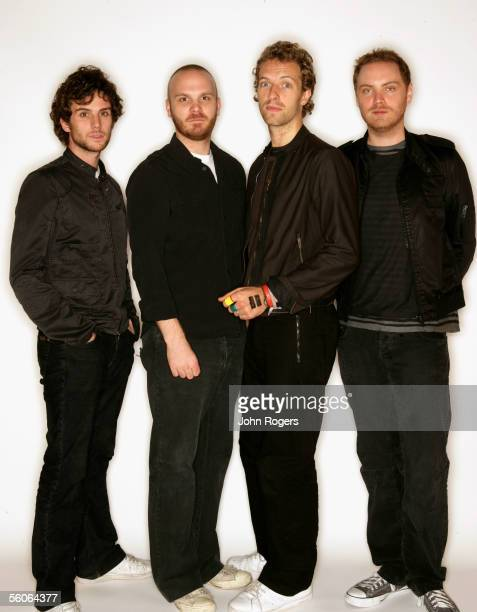 Guy Berryman Will Champion Chris Martin and Jonny Buckland of Coldplay nominated for the award for Best Album pose for a portrait in the backstage...