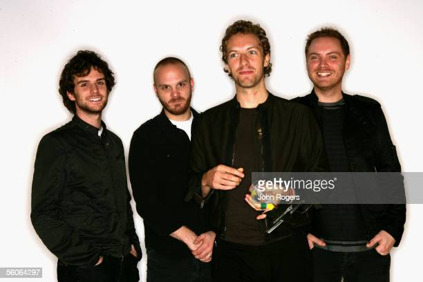 Guy Berryman Will Champion Chris Martin and Jonny Buckland of Coldplay pose for a portrait in the backstage studio at the 12th annual MTV Europe...