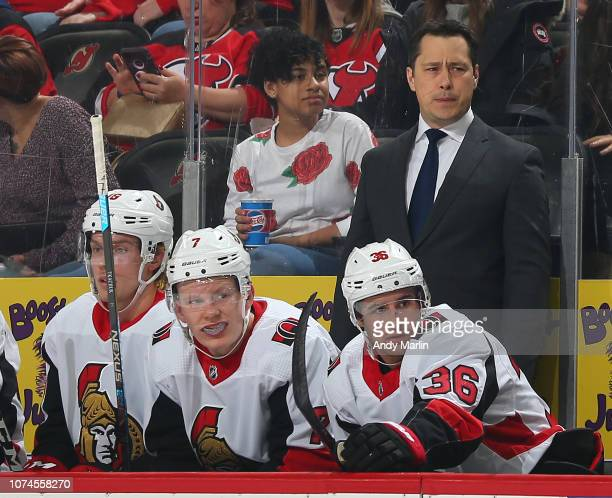 Guy Boucher head coach of the Ottawa Senators looks on from the bench during the first period against the New Jersey Devils at the Prudential Center...