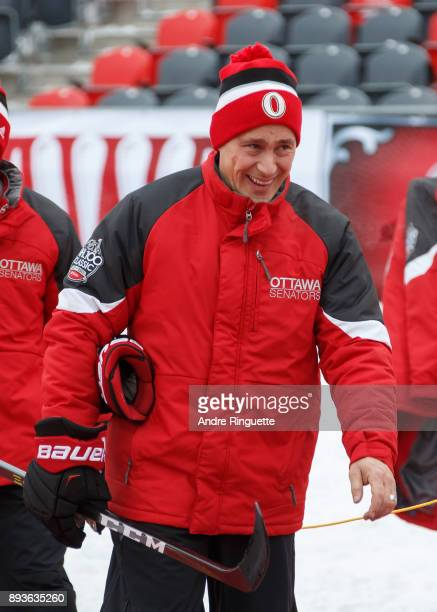 Guy Boucher Head Coach of the Ottawa Senators makes his way onto the ice during a practice session ahead of the Scotiabank NHL100 Classic at...
