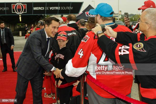 Guy Boucher head coach of the Ottawa Senators walks the red carpet prior to the start of a game against the Detroit Red Wings at Canadian Tire Centre...