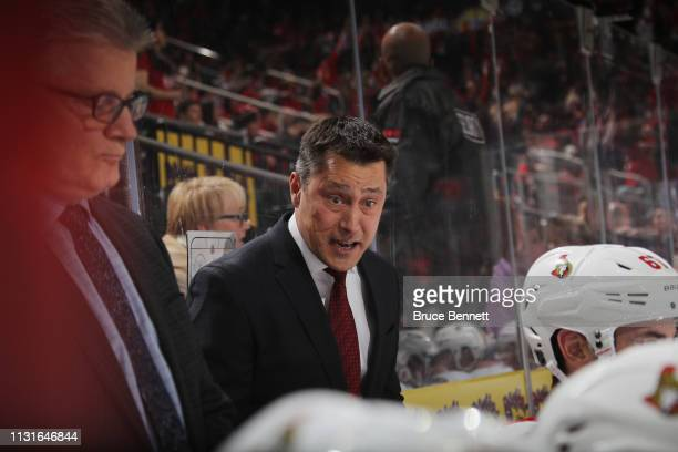 Guy Boucher of the Ottawa Senators handles bench duties against the New Jersey Devils at the Prudential Center on February 21 2019 in Newark New...