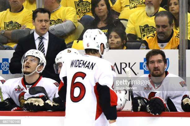 Guy Boucher of the Ottawa Senators looks on during the first period against the Pittsburgh Penguins in Game One of the Eastern Conference Final...