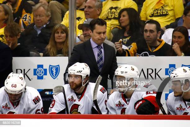 Guy Boucher of the Ottawa Senators reacts against the Pittsburgh Penguins during the third period in Game Two of the Eastern Conference Final during...