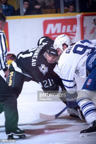 Guy Carbonneau of the Dallas Stars skates against Doug gilmour of the Toronto Maple Leafs during NHL game action on December 9 1995 at Maple Leaf...