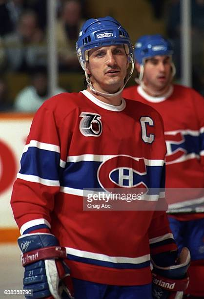 Guy Carbonneau of the Montreal Canadiens prepares for the faceoff against the Toronto Maple Leafs during NHL game action on December 9 1991 at Maple...
