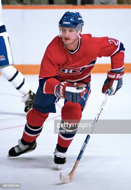 Guy Carbonneau of the Montreal Canadiens skates up ice during NHL game action against the Toronto Maple Leafs on December 7 1985 at Maple Leaf...