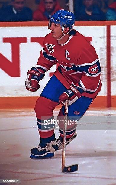 Guy Carbonneau of the Montreal Canadiens turns up ice against the Toronto Maple Leafs during NHL game action on December 9 1991 at Maple Leaf Gardens...