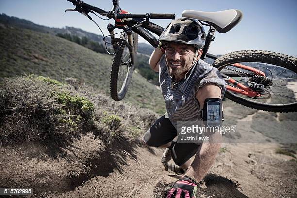 Guy Carrying Mountain Bike up Steep Slope, Gear