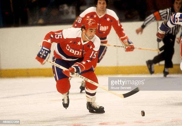 Guy Charron of the Washington Capitals skates with the puck during an NHL game against the New York Rangers on October 14 1979 at the Madison Square...