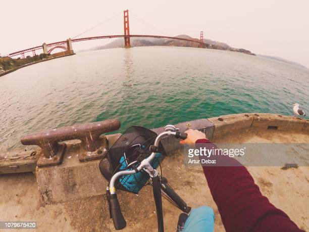 guy contemplating the golden gate bridge with bicycle. - wide angle stock pictures, royalty-free photos & images