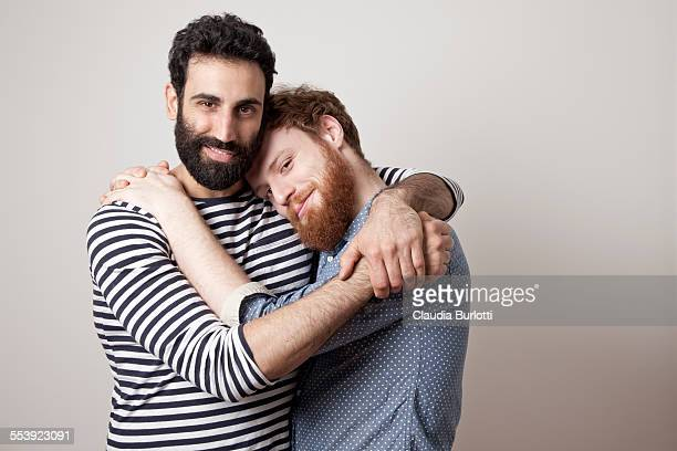 Guy couple smiling and hugging