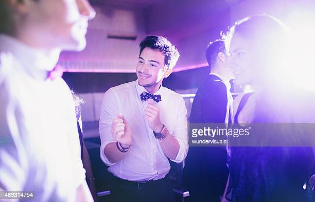 Guy dancing and having fun with friends on dance floor