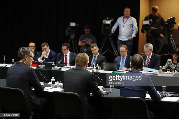 Guy Debelle deputy governor of the Reserve Bank of Australia from left Philip Lowe governor and Christopher Kent assistant governor attend a hearing...