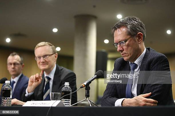 Guy Debelle deputy governor of the Reserve Bank of Australia from right Philip Lowe governor and Christopher Kent assistant governor attend a hearing...