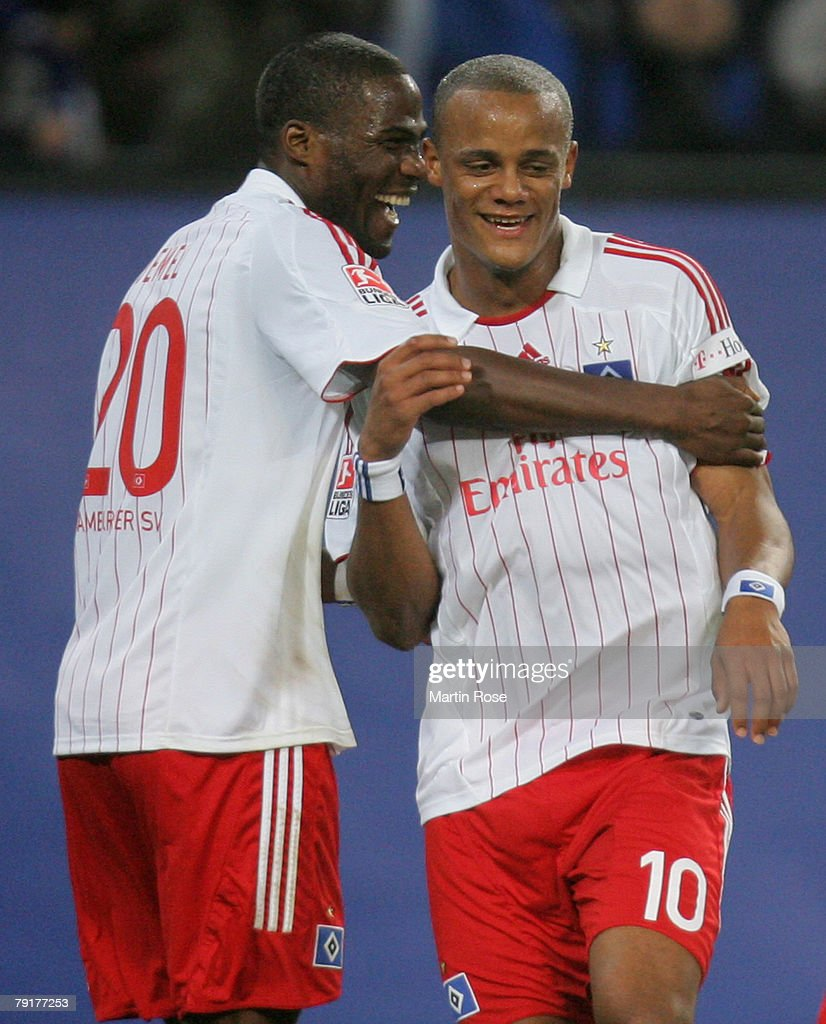 Guy Demel (L) of Hamburg celebrates with his team mate Vincent Kompany (R) the 2nd goal during the friendly match between Hamburger SV and FC Midtjyland at the HSH Nordbank Arena on January 23, 2008 in Hamburg, Germany.