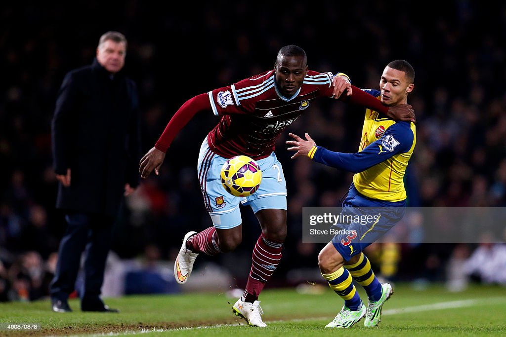 Guy Demel of West Ham battles for the ball with Kieran Gibbs of Arsenal during the Barclays Premier League match between West Ham United and Arsenal at Boleyn Ground on December 28, 2014 in London, England.