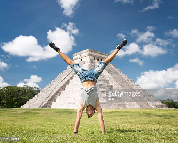 Guy doing a Handstand, Chichen Itza Mexico