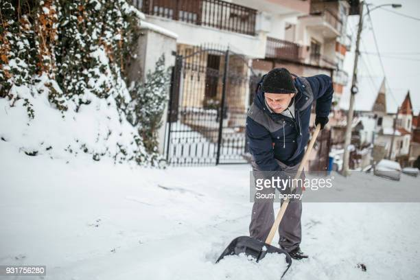guy doing winter chores - digging stock pictures, royalty-free photos & images