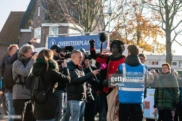 A guy dressing as a Black Pete tried to get closer to the anti Black Pete demonstrators but was blocked by the security and the police in Zaandstad...
