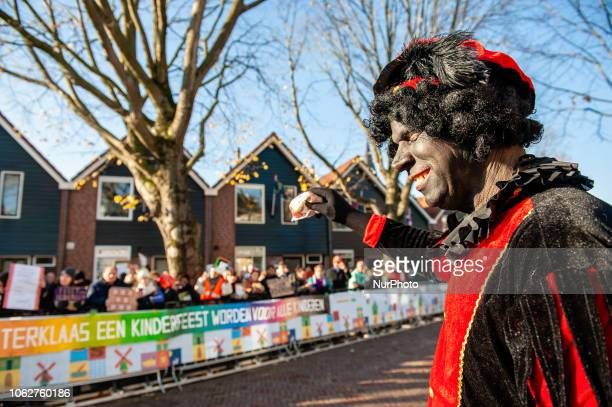 A guy dressing as a Black Pete was making a mockery in front of the anti Black Pete demonstrators in Zaandstad Netherlands Like each year the first...