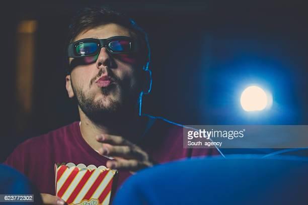 Guy enjoying popcorn at the cinema