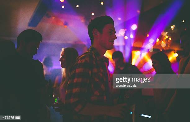 Guy enjoying the night club vibes in a relaxed style