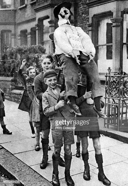Guy Fawkes Day London 19261927 Children with a homemade 'guy' collecting money to buy fireworks Illustration from Wonderful London edited by Arthur...