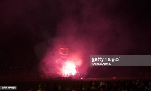 Guy Fawkes' effigy is being lit up by The Waterloo society in town of Lewes East Sussex England during the annual bonfire night procession is held by...